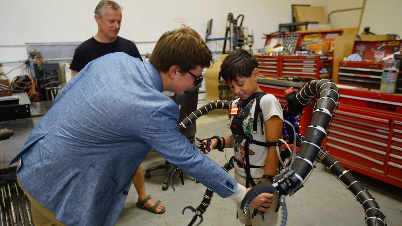 Featured image of World's Youngest Bitcoin Millionaire 3D Prints Functional Dr. Octopus Suit to Defeat Hypermobility