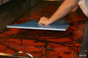 Hydro dipping a plate in a dipping tank