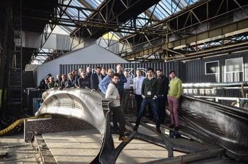 The MX3D team standing on its 3D-printed bridge