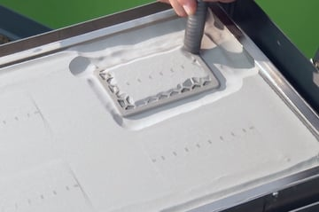 Removing unfused powder