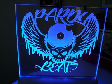 An edge-lit sign, illuminated with blue LEDs.