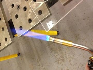 Flame polishing acrylic.