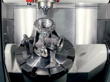 An industrial CNC machine at work.
