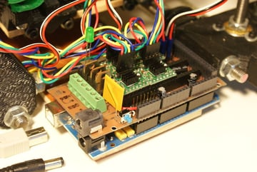 An early DIY RAMPS 1.2 board sits on top of an Arduino Mega.