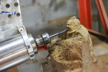 A 5-axis CNC mill at work.
