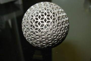 Metal orb with a complex shape, produced via SLM technology.