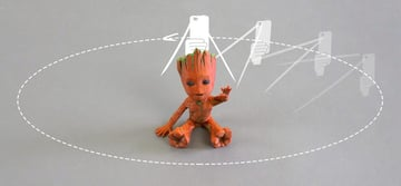 Picture of a baby Groot being photoscanned.