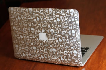 An ornate laser-etched MacBook, showing off its case.