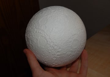 A moon 3D printed in White Hatchbox PLA.