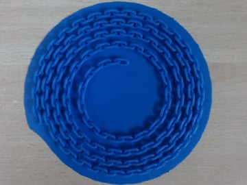 A print-in-place chain by ferjerez on Thingiverse, printed with ABS.
