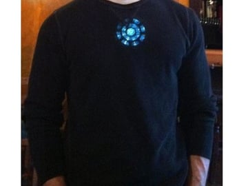 The printed wearable arc reactor looks pretty realistic when outfitted with LEDs.