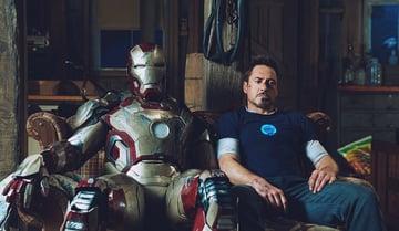 The MK42 suit next to Iron Man actor Tony Stark.