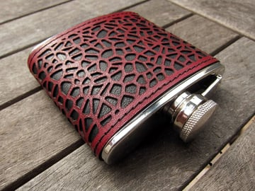 A flask covered with laser-cut leather.
