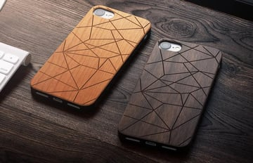 Wooden phone cases with geometric pattern.