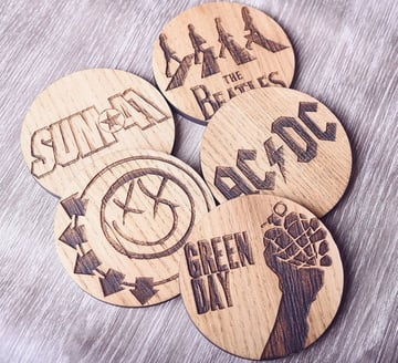 Engraved wood coasters by Maison Creations.