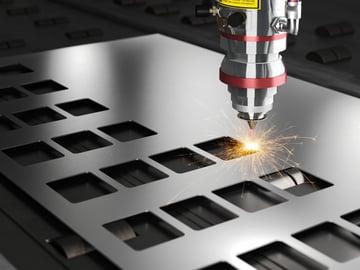 A laser cutter cutting metal.