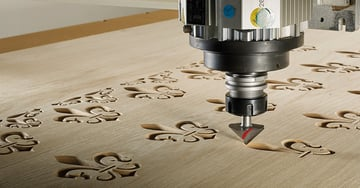 A CNC router cutting repetitive, intricate patterns.
