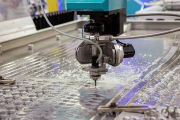 A water jet cutter at work