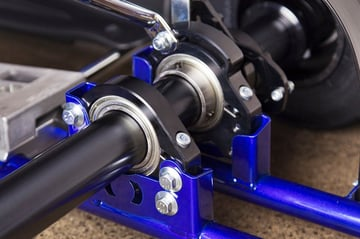 Multiple bearings on the rear axle of a go-kart require geometric tolerancing.