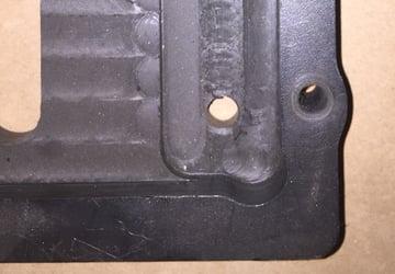 A machined tray with dog bone corners.
