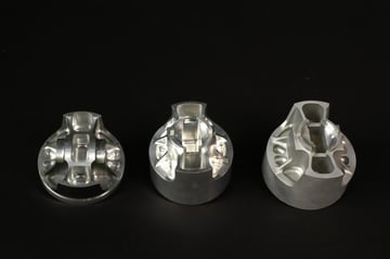 Bead-blasted billet piston (far right) on underside to eliminate stress risers in machining.