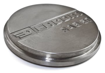 Engraving over embossing on machined parts.