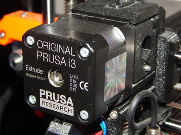 The extruder motor on a Prusa i3 MK3 is known to get quite hot during use.