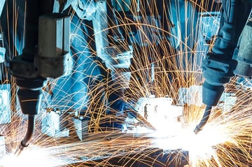 Machines like these appear in an FMS to weld parts.