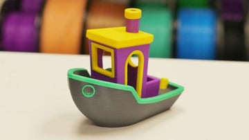 The popular 3D Benchy printed in multicolor.