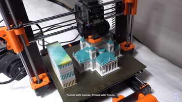 A transition tower being printed alongside the main model.