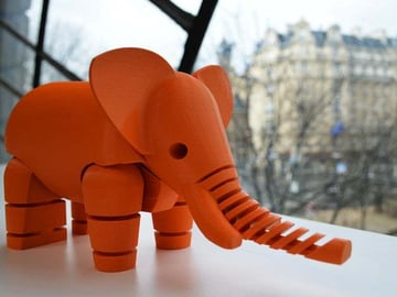 The elephant in pumpkin orange.