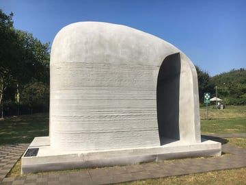 A 3D printed concrete structure by XtreeE.