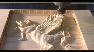 CNC cutting a relief carving of Pegasus.