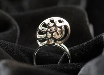 A silver nautilus ring printed by i.Materialise