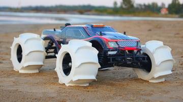 Custom 3D printed tires on a regular RC car.