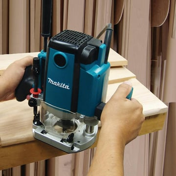 A Makita plunge router working its magic