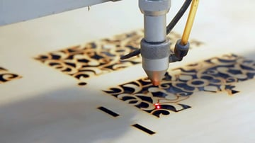 A laser cutter in action