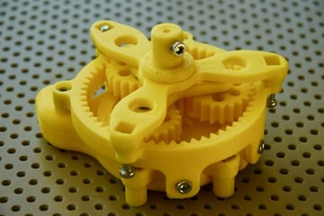 This planetary gear is a motor powered by water pressure
