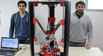 Oliver Tolar and Denis Herrmann with their 6-axis 3D printer