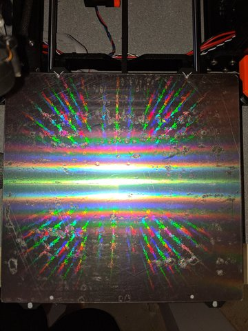 Applying a plastic diffraction grating surface to a build plate