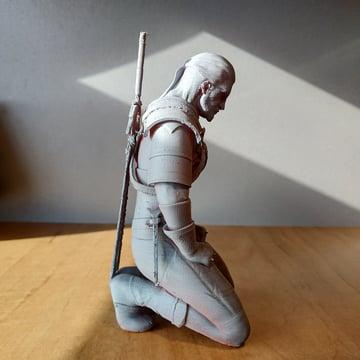 Geralt kneeling to meditate