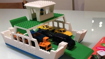 This floating ferry is fun on land or in the pool, but be careful not to lose your bricks in the filters!