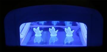 Curing SLA prints under UV light to reach full strength