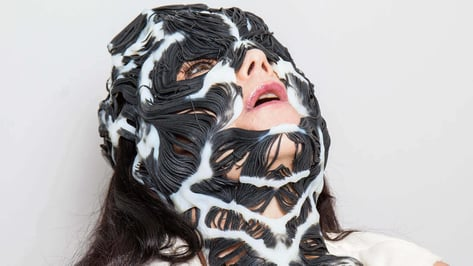 Featured image of Björk Wears 3D Printed Rottlace Mask for Live Performance