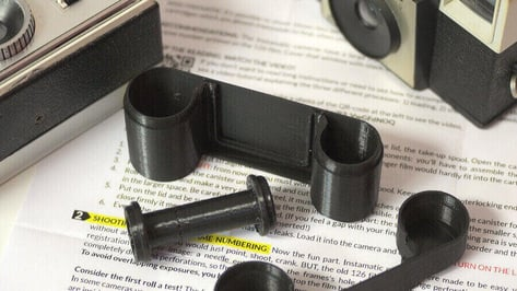 Featured image of 3D Printed Camerhack Adapter Allows Old Instamatic Cameras To Use 35mm Film