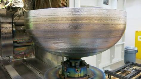 Featured image of Lockheed Martin 3D Prints Titanium Domes for Satellite Fuel Tank