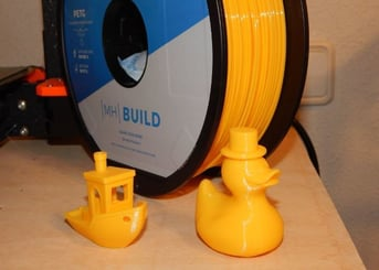 Two of our test prints, spool in rear.
