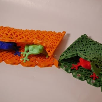The Chainmail Wallet securing some frogs.