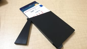 A slim wallet with slider and cap.