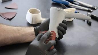 Sanding a 3D printed part.